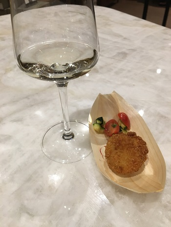 Sip & Sizzle pairing of Two Sisters Sauvignon Blanc and a cod fritter.