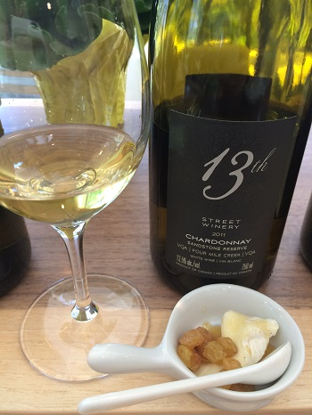 13th Street Winery 2011 Sandstone Reserve Chardonnay paired with brie and Chardonnay-soaked raisins.