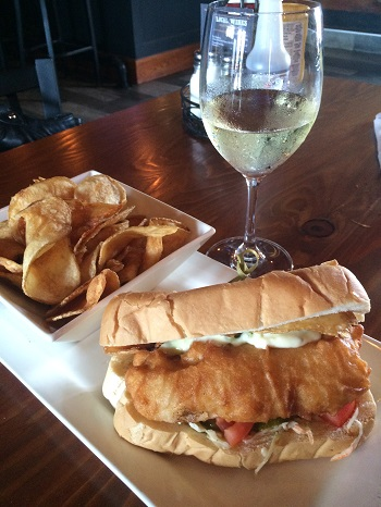 A glass of local Chardonnay and a fish hoagie at Billy's Taphouse in Windsor/Essex.